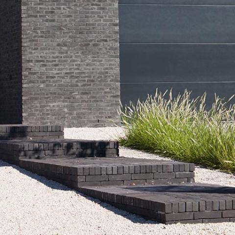 Tuin met niveauverschil mooie ontwerpen door for Tuinarchitect gent